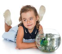 Girl admiring the aquarium Stock Photos