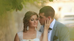 Tender moment of love. Bride softly strokes groom's face and smiling. Old city Stock Footage