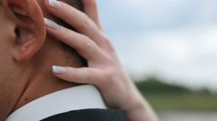 Beautiful young couple softly embracing close-up. Lovely hand of bride stroking Stock Footage