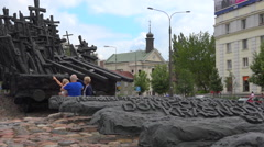Tourist visiting Monument to the Fallen and Murdered in the East in Warsaw - pan Stock Footage