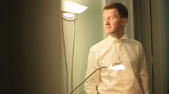 Happy elegant groom getting ready for the wedding day in the hotel room Stock Footage