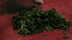 Chef cutting greenery finely, close up - stock footage