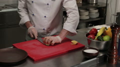 Chef putting diced potato into the plate Stock Footage