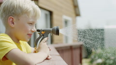 Watering a plant with a hose Stock Footage