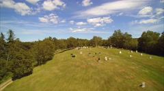 Camera rises from cemetery to reveal beautiful Cape Breton countryside Stock Footage