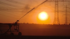 Industrial irrigation of a salad field with a sunset, germany Stock Footage