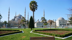 Daily life in the park in front of the blue mosque Stock Footage