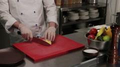 Chef slicing a potato, finely, medium shot Stock Footage