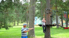 A child climbs on the rope road Stock Footage