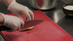 Chef in slicing a potato finely, close up Stock Footage