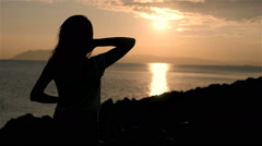 Back Side View On a Silhouette of Wonderful Young Woman Watching To Sea And Stock Footage
