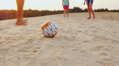 Family playing football. In the frame of the man legs hit the ball the ball on Stock Footage
