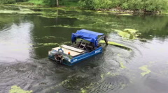 Algae removal from a lake with a boat Stock Footage