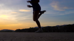 Woman warm up before training at sunset Stock Footage