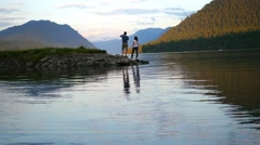 love couple walking on river at sunset - stock footage