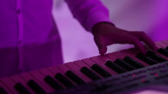 A man playing on a synthesizer Stock Footage