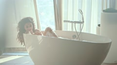 Sensual lady taking a bath - stock footage