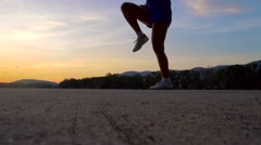 Woman warm up before training at sunset, slow motion Stock Footage