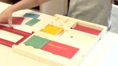 Child draws via rarity frame-hatch,time lapse Stock Footage