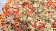 Freshly baked pizza with tomato meat Stock Footage