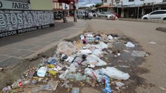 Trash/Litter on Colombian street corner (HD) Stock Footage