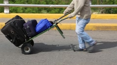 Man Pushing Food Filled Luggage on Handtruck (HD) Stock Footage
