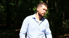 Model bearded man posing in the forest Stock Footage