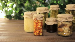 Homemade canned organic vegetables in glass jars. Stock Footage