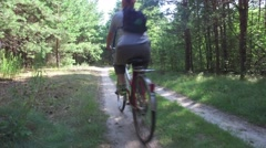 Woman on bicycle travels and photographs the phone Forest Stock Footage