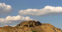 excavator and dump truck skill work on construction of new highway. Time lapse - stock footage