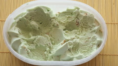 Two person take the pistachio ice cream Stock Footage