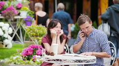 Restaurant tourists couple at outdoor cafe. Young girl sad at her boyfriend - stock footage