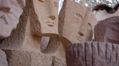 Stone carved faces in Quarry Stock Footage