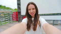 Young girl making video selfie and having fun in the park. Lifestyle selfie Stock Footage