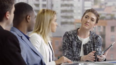 Business woman leading a team meeting, wide shot Stock Footage
