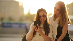 Caucasian girls making selfie background soft sunset light. Young tourist Stock Footage