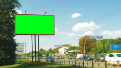 A large billboard on the sidelines of a city street, a green screen Stock Footage