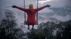 Woman in a swing over the mountains Stock Footage