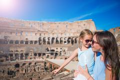 Young mother and little girl exploring Coliseum inside in Rome, Italy. Family Stock Photos