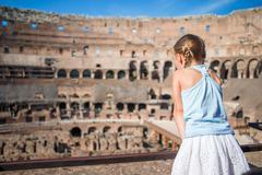 Little girl in Coliseum, Rome, Italy. Back view of kid looking at famous places Stock Photos