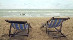 Peaceful Beach with Reclining Beach Chairs Stock Footage