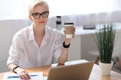 Woman having coffee pause while working Stock Photos