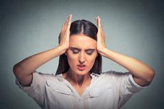 Stressed sad woman, having migraine, tension headache Stock Photos