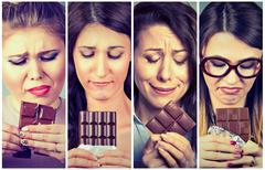 Sad young women tired of diet restrictions craving sweets chocolate. Stock Photos