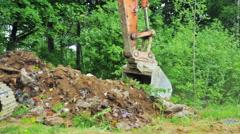 Excavator bucket clears the site of debris. Stock Footage