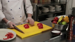 Chef cutting red bell pepper finely, medium shot Stock Footage