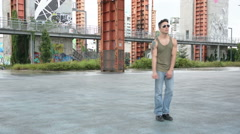 Young male hip-hop dancer dancing outside Stock Footage