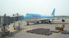 Korean Air airplane moving slowly towards the arrival gate. Stock Footage