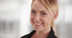Happy businesswoman smiling at camera Stock Footage