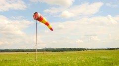 Summer day on sport airport with moving abandoned windsock, wind is blowing Stock Footage